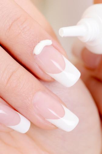 cosmetic  moisturizing cream on female fingernail